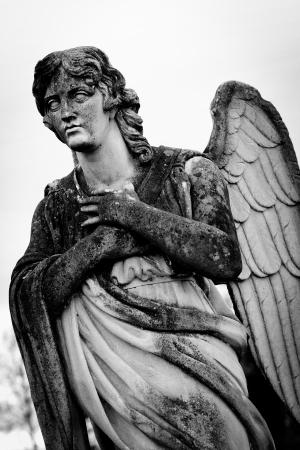 weeping angel: guardian angel statue