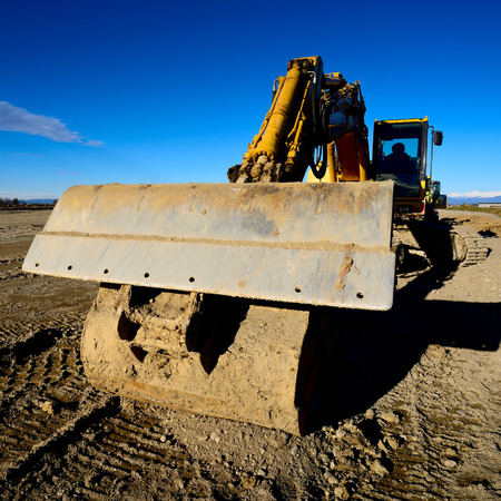 earth mover: new road construction earth mover Stock Photo
