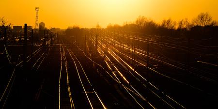 return trip: railroad to milan city at sunset