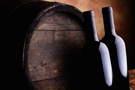 wine bottles and barrel Stock Photo