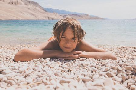 little boy on the beach photo