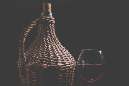 carboy: little wine carboy and wine glass Stock Photo
