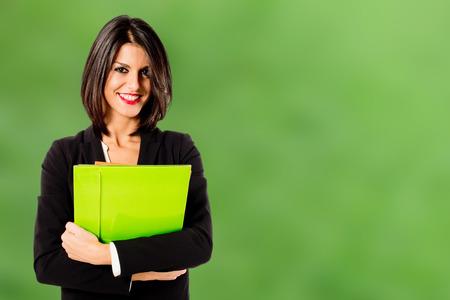 面帶微笑的職業女性在綠色的背景
