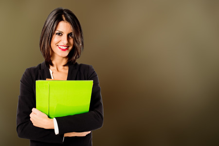 smiling professional woman on brown background 版權商用圖片
