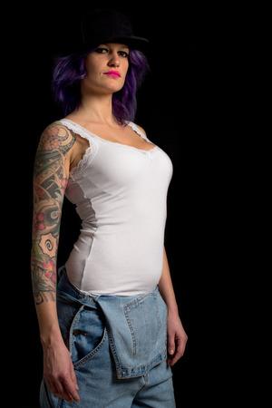 tattoed dominant woman Stock Photo