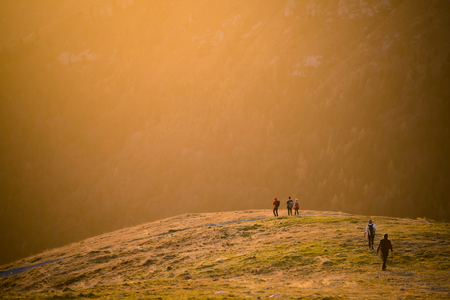 back home: hikers back home at sunset