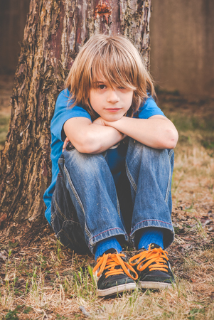 unhappiness: a brat little boy - sadness Stock Photo