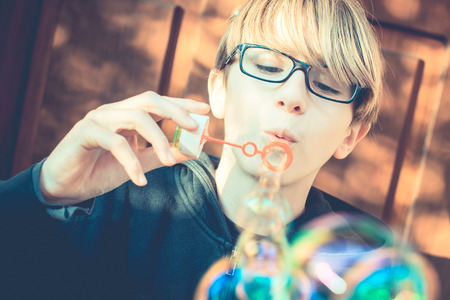 normal school: an ordinary day - soap bubbles after school - vintage style photo Stock Photo