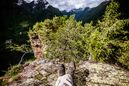 observes: Observes hiker rests and the landscape - outdoor activity in italy
