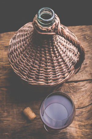 little wine carboy and wine glass Stock Photo