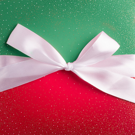 red and green gift box with white ribbon