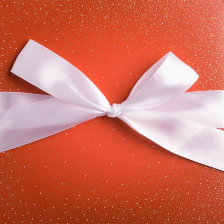 orange gift box with white ribbon