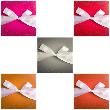 multiple images: multiple images of colored gift box with white ribbon isolated on white background Stock Photo