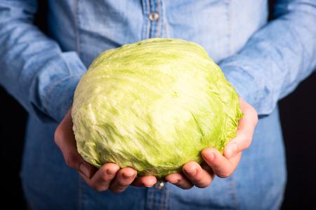ice salad in hands - vegetarian and vegan people