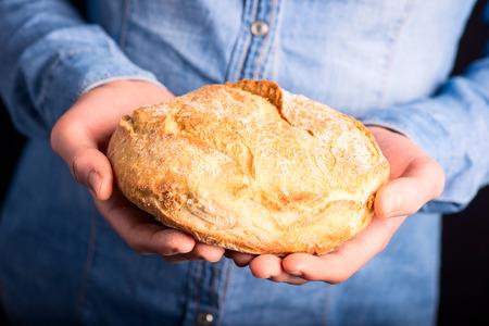 bread in hands - vegetarian and vegan
