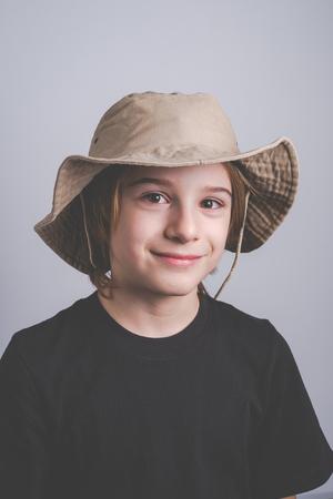 young boy scout smiling portrait - vintage style photo
