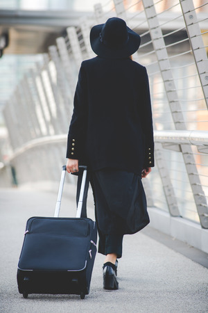 young authentic business woman in the city for a buisness trip 版權商用圖片