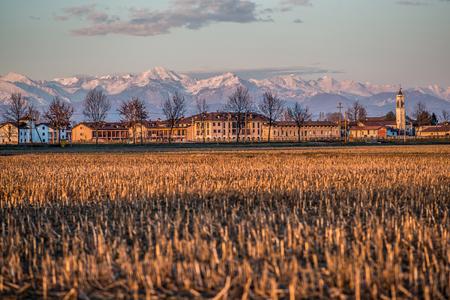 po: Po Valley countryside village at sunset Italy - italian landscape Stock Photo