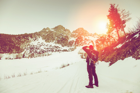 man loking at the mountain top - wanderlust travel concept excursion in wild nature - outdoor activity Alps Italy 版權商用圖片