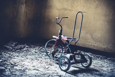 abandoned vintage tricycle - objects and places lost in time
