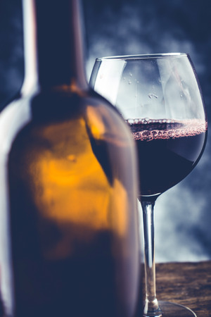 red wine glass and bottle - fine wine tasting concept