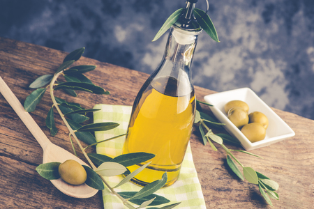 olive oil bottle on rustic table - italian food concept