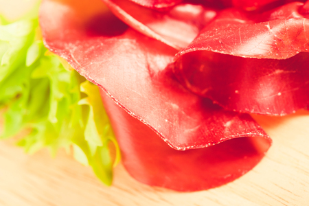 italian bresaola prosciutto -typical food made of cow meat of the Valtellina Lombardia Italy 版權商用圖片