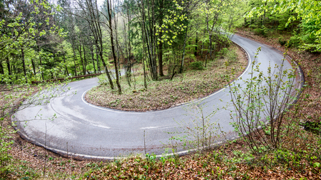 hairpin bend of mountain road - outdoor activity and spring season