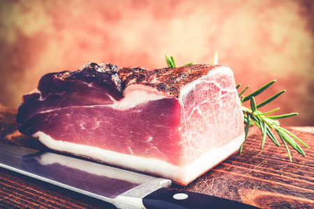 italian speck smoked prosciutto - typical food made of pork meat in Italy