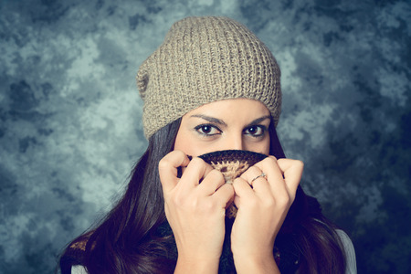 shy mediterranean young woman with long brown hair - face expressions - filtered vintage style photo