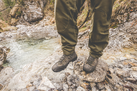 exploring the little creek - outdoor activity italian Alps - vintage filter 版權商用圖片