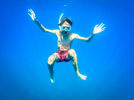 teenager having fun in the sea - summertime - Sicily mediterranean sea