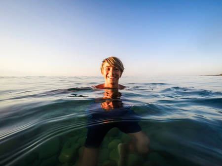 teenager swim in the sea - summertime - Sicily mediterranean sea