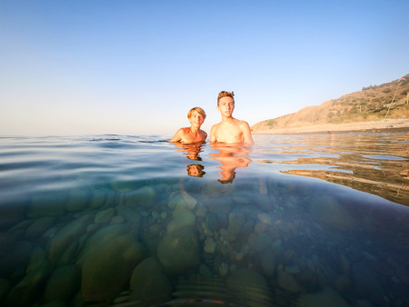 teenagers portrait in the sea - summertime - Sicily mediterranean sea