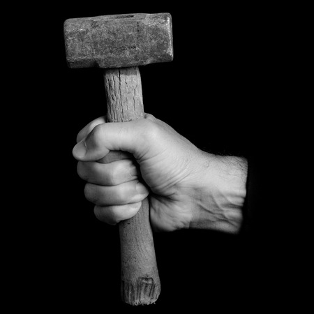 mallet - tools in a mans hand - black and white photo 版權商用圖片