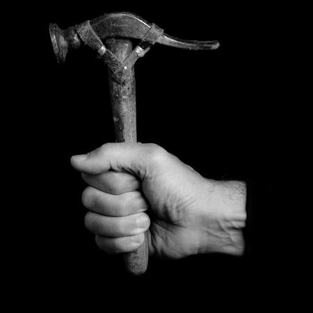錘子工具在一個男人的手 - 黑白照片 版權商用圖片