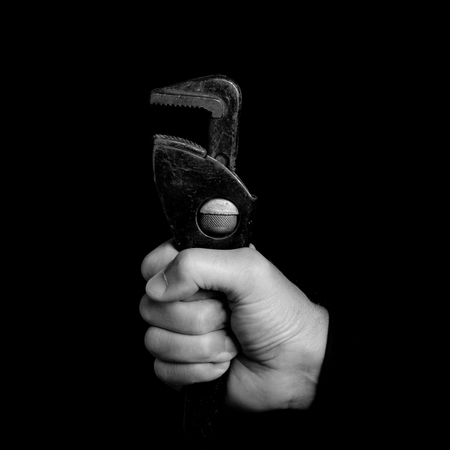 spanner - tools in a mans hand - black and white photo 版權商用圖片