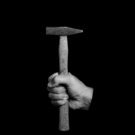 hammer- tools in a mans hand - black and white photo