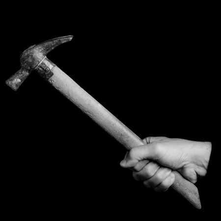 bricklayer  hammer- tools in a mans hand - black and white photo 版權商用圖片