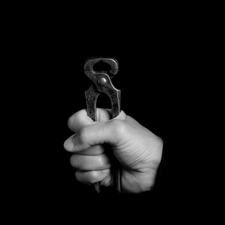 pincer - tools in a mans hand - black and white photo