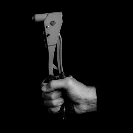 riveter - tools in a mans hand - black and white photo 版權商用圖片