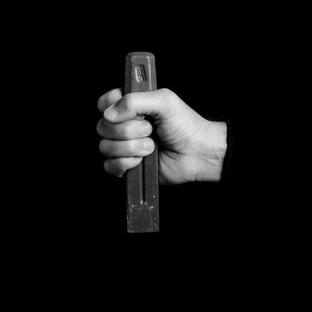 chisel - tools in a mans hand - black and white photo