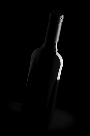 wine bottle on black background - black and white photo