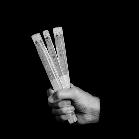 meter - tools in a mans hand - black and white photo