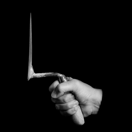 masons trowel - tools in a mans hand - black and white photo