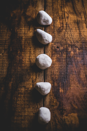 zen stones on wooden background