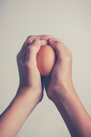egg in human hands - protection concept 版權商用圖片