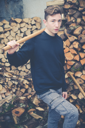 young boy prepares firewood - vintage style photo 版權商用圖片