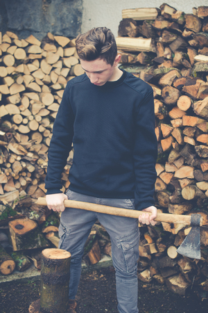 young boy prepares firewood - vintage style photo Stock Photo