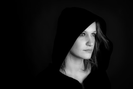 portrait of hooded woman - black and white image